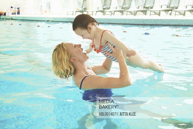 Mother and Daughter in Indoor Swimming Pool