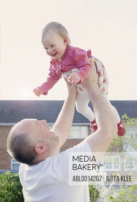 Father Playing with Daughter Outdoors