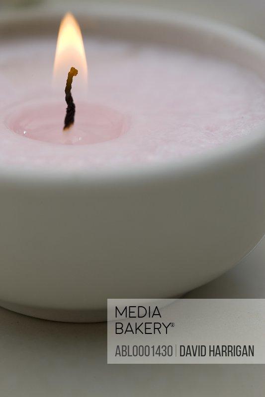 Extreme close up of a burning tea light