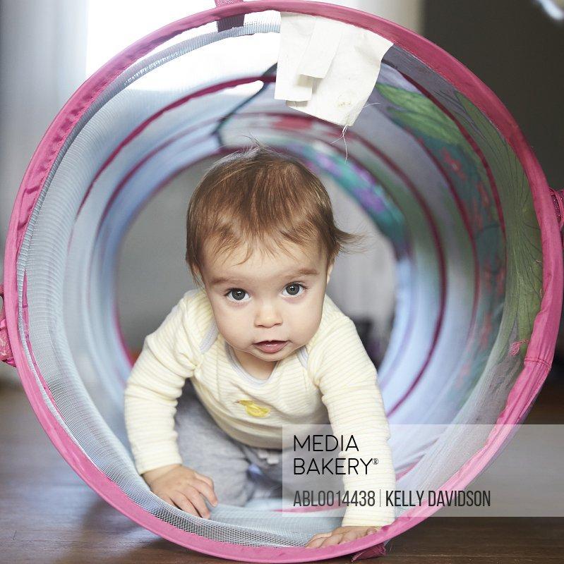 Baby Girl Crawling through Toy Tunnel