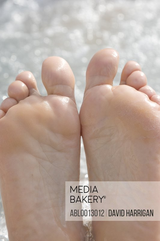 Close up of a man's feet in bubbling water