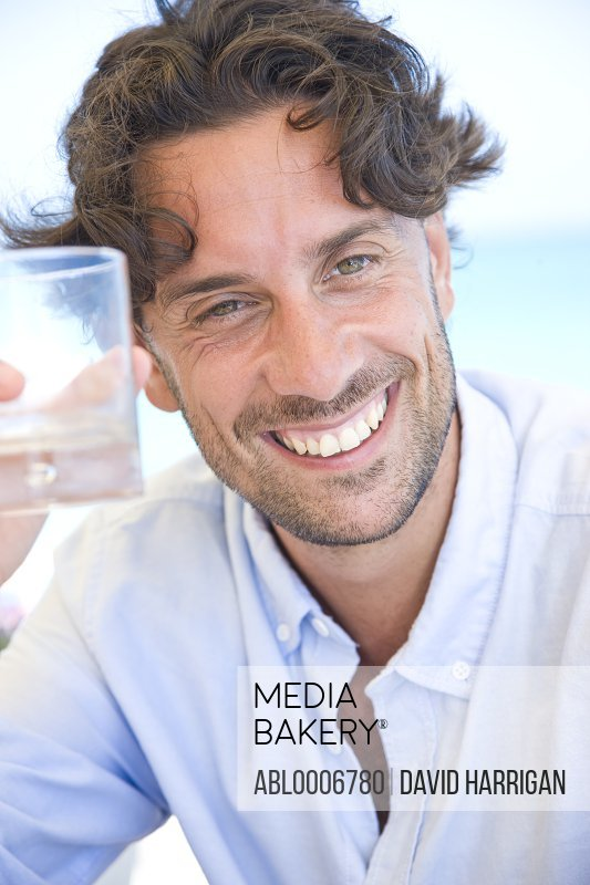 Smiling Man Holding Glass
