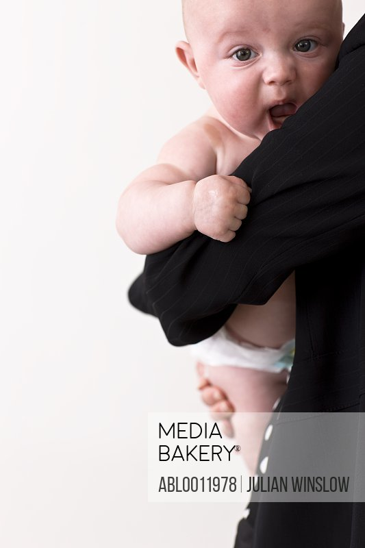 Back view of a woman holding a baby