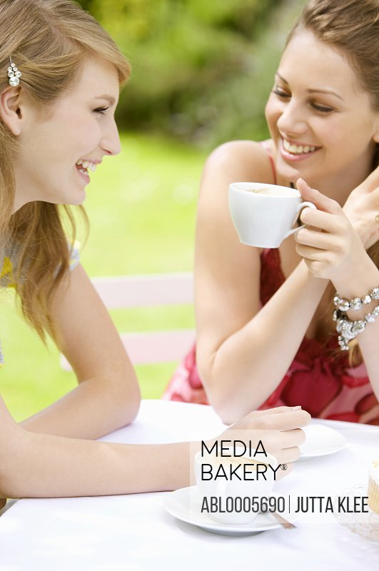 Two young women having coffee