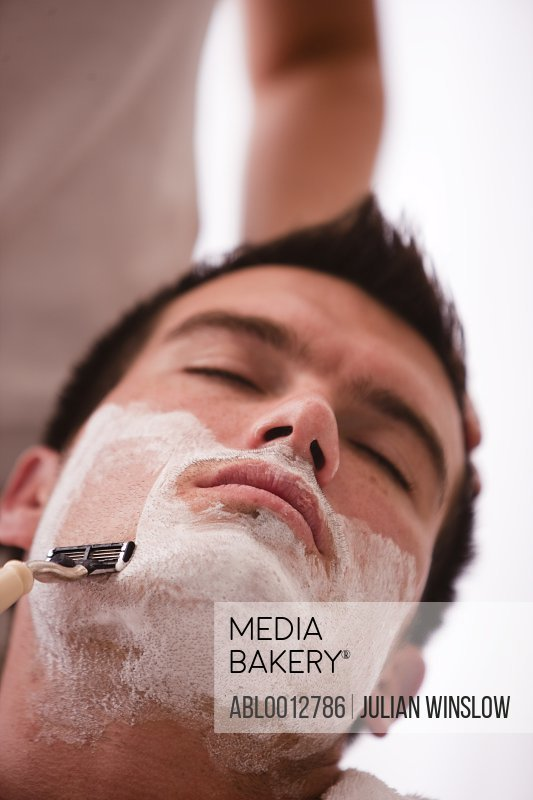 Close up of a man getting a shave