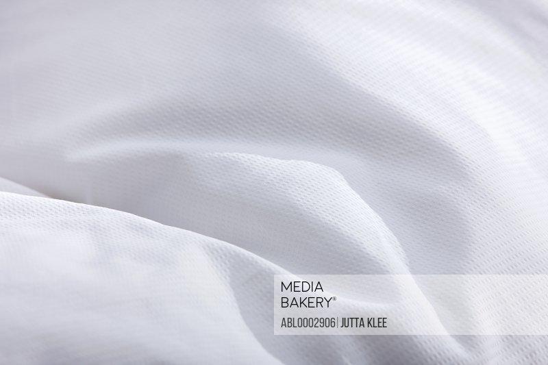 Detail of White Bed Cover, Full Frame