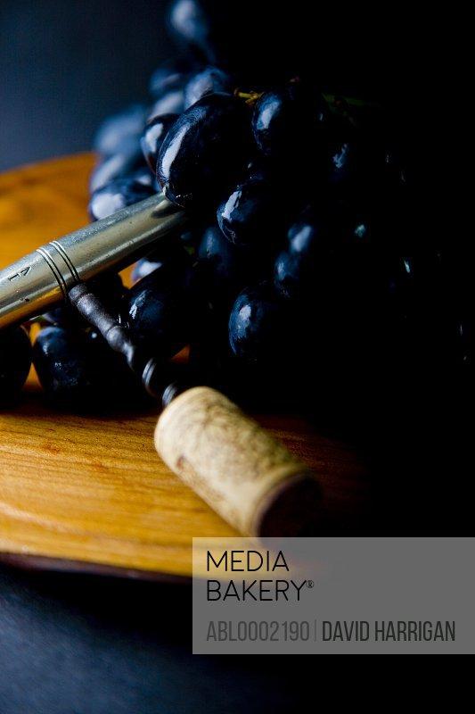 Black Wine Grapes and Corkscrew
