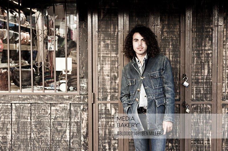 Man Standing in front of Store Door