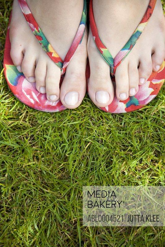 Close up woman feet wearing flip flops