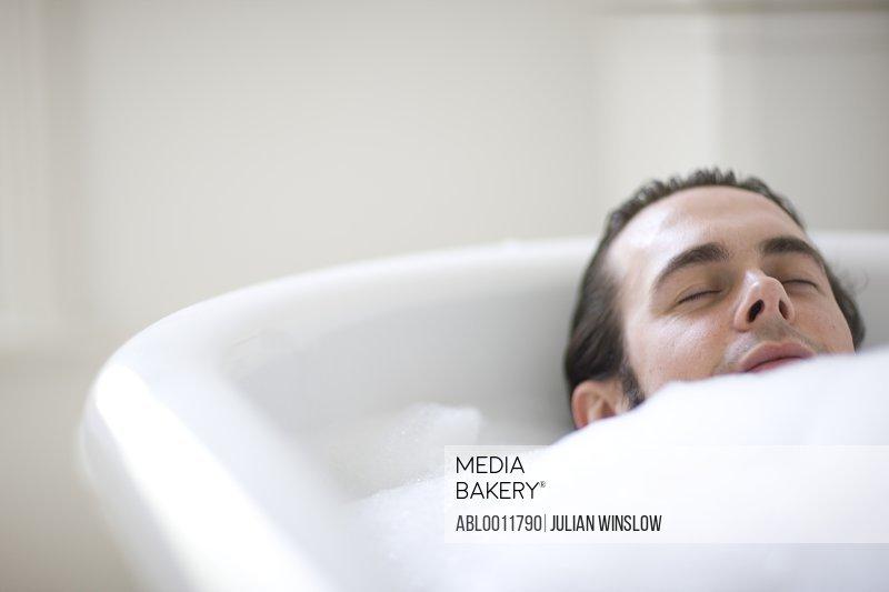 Close up of young man having a bath