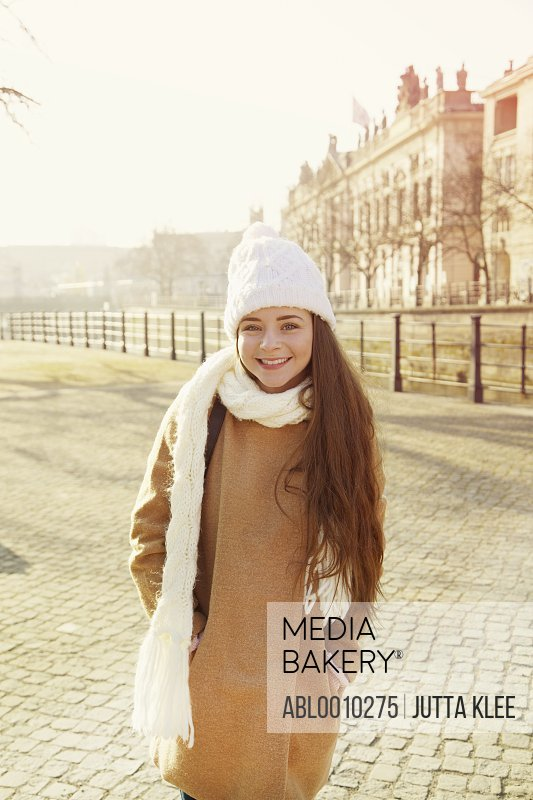 Teenage Girl Wearing Wool Hat and Scarf Smiling, Berlin, Germany