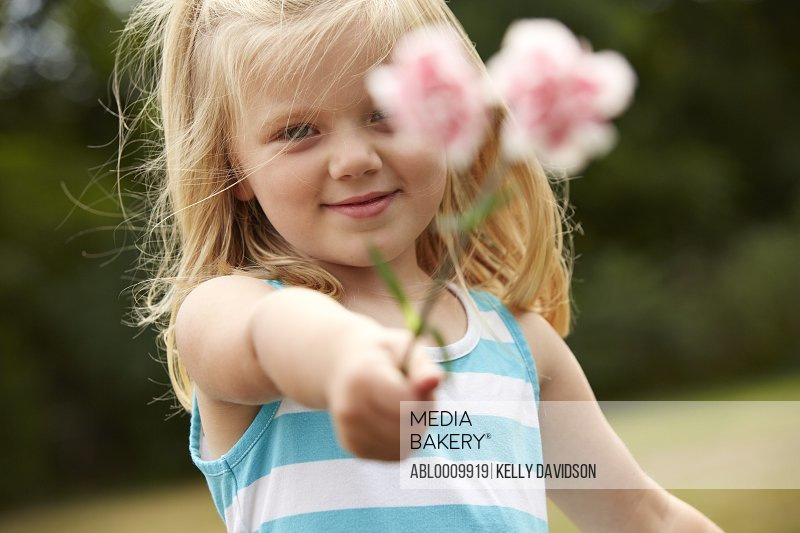 Young Girl Holding Pink Carnations