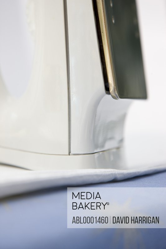 Close up of a iron on an ironing board