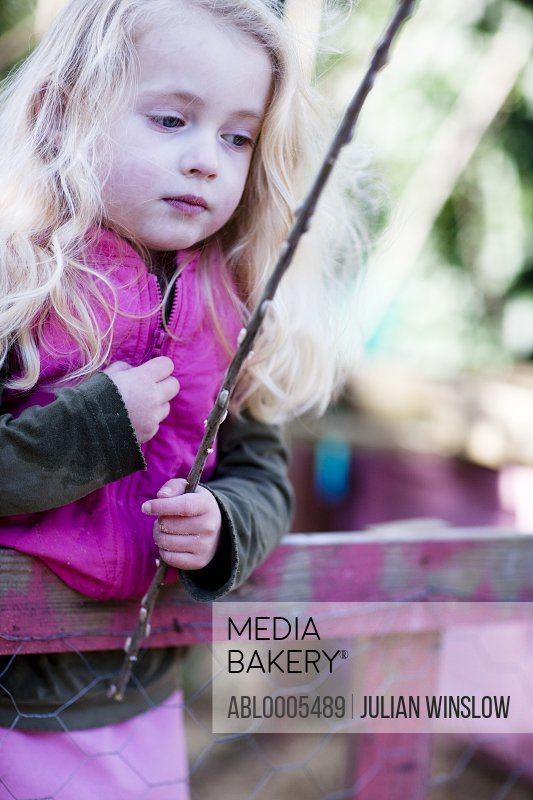 Girl holding a stick