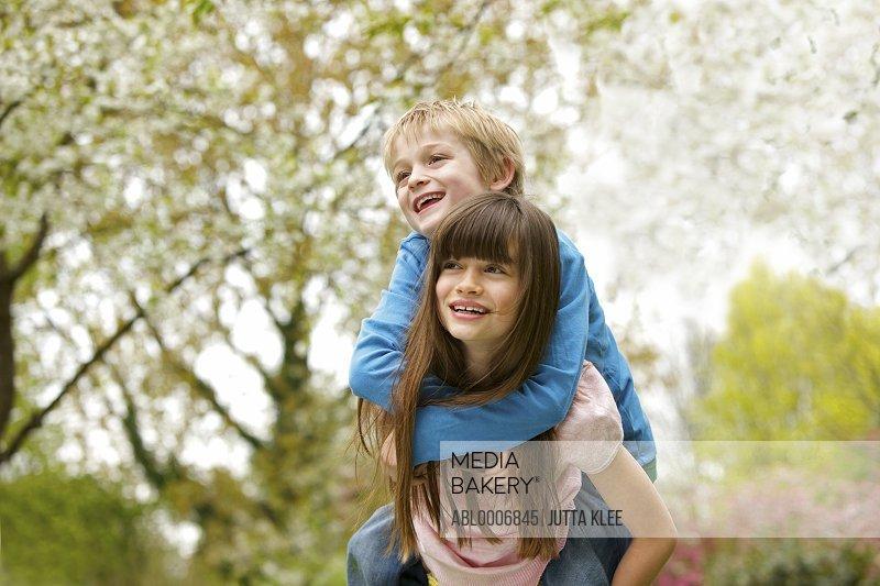 Boy and Girl Riding Piggyback Outdoors