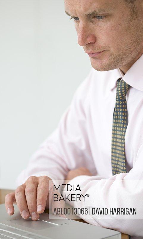 Close up of Businessman Using Laptop