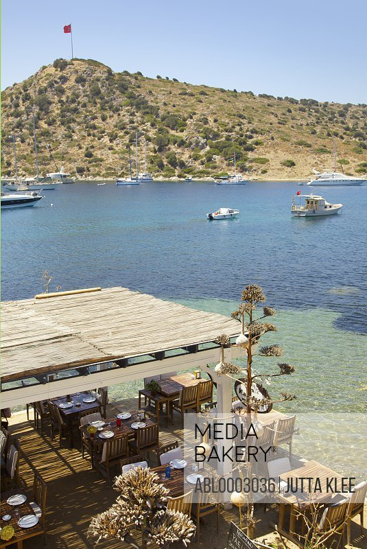 Restaurant overlooking Gumusluk Bay, Bodrum Peninsula , Turkey