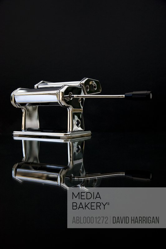 Shiny chrome plated pasta maker with mirror image reflection
