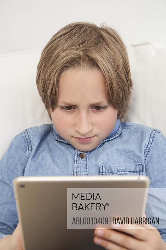 Young Boy Using Digital Tablet