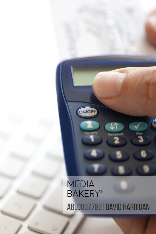 Man Holding an Internet Banking Card Reader