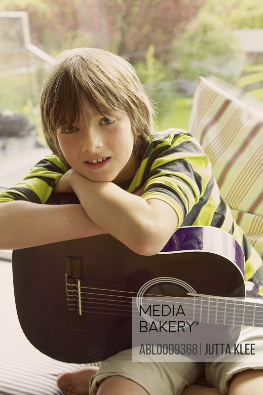 Boy Holding Guitar