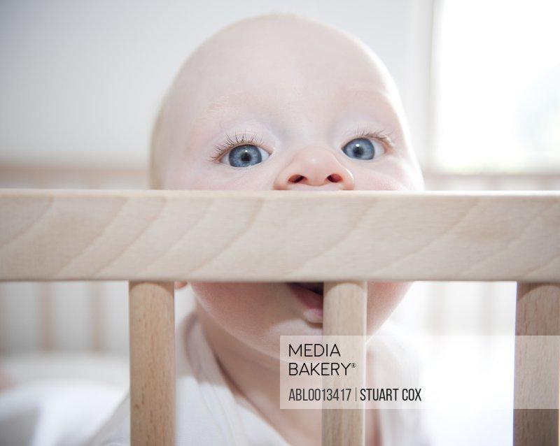 Baby Girl Biting Edge of Crib