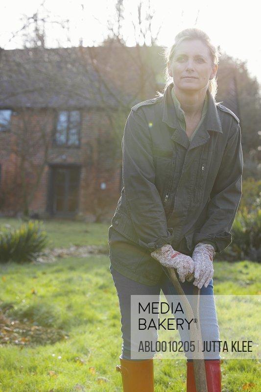 Woman Gardener Leaning on Spade