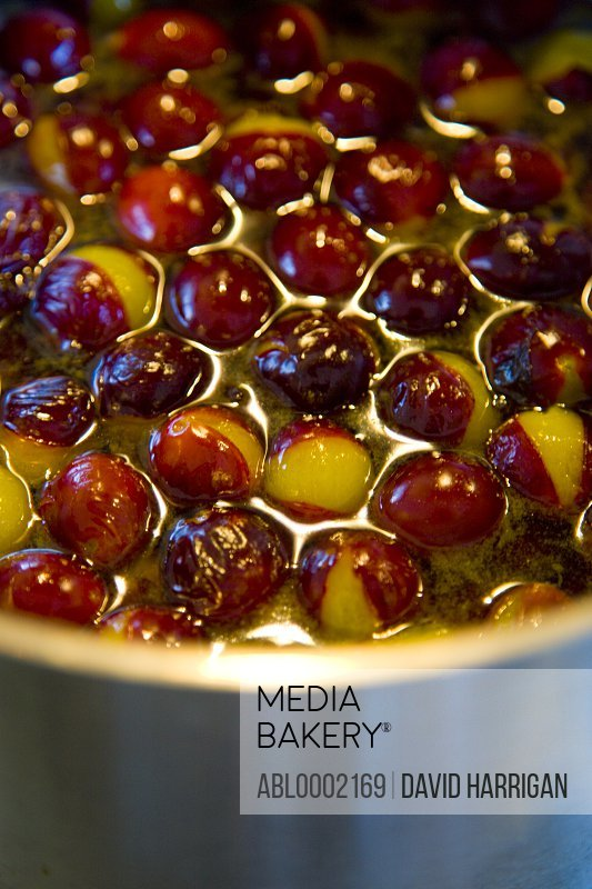 Damson Plums Simmering in a Pan - Close-up view