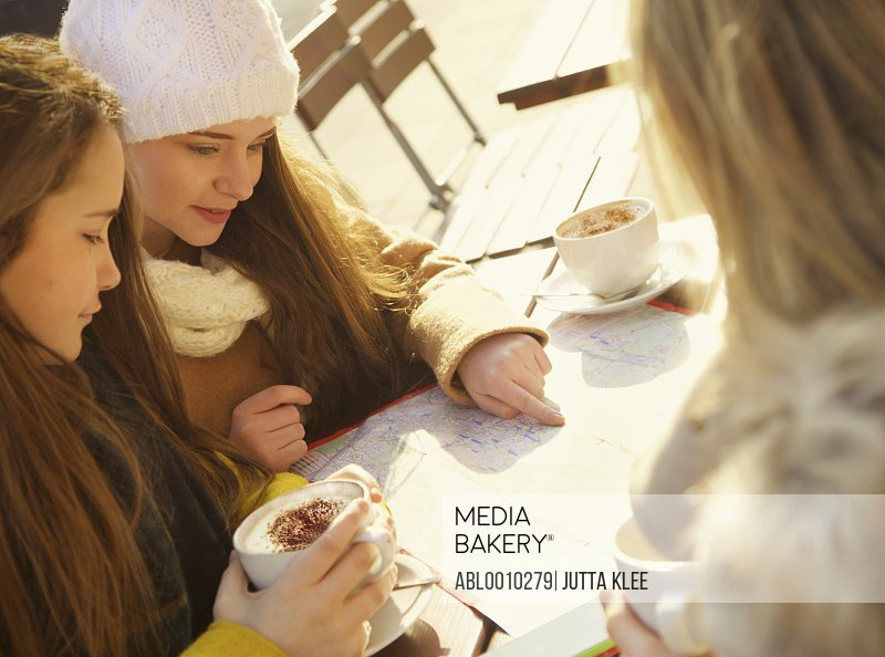 Teenage Girls at Cafe Looking over a Map
