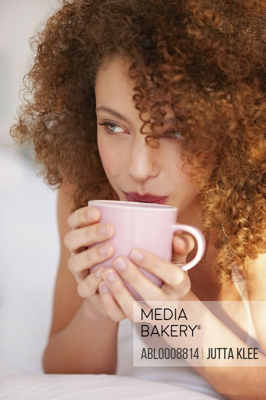 Close up of Young Woman Sipping Hot Drink