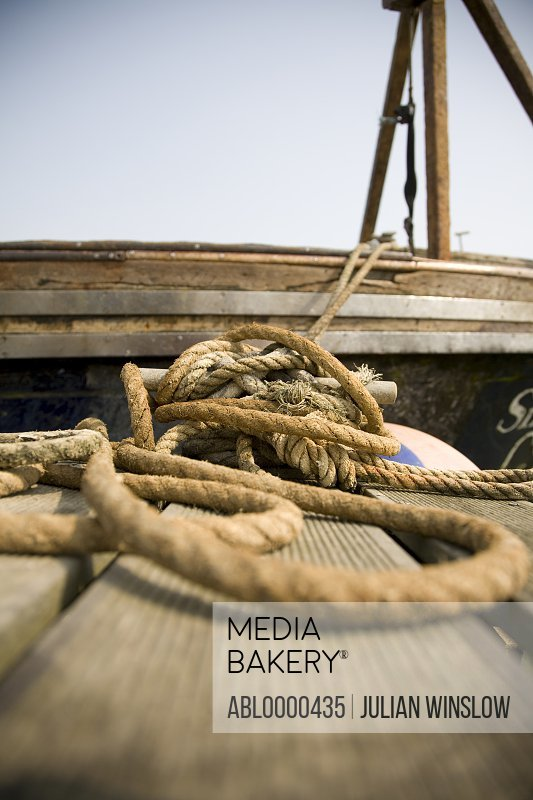 Extreme close up of jute dock line holding boat