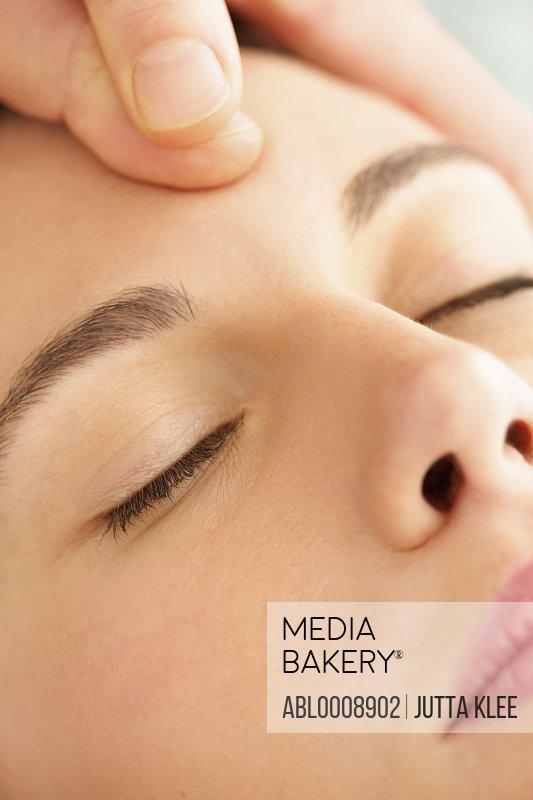 Woman Receiving a Facial Massage, Close-up View