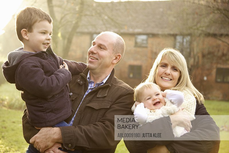 Portrait of Family of Four Outdoors