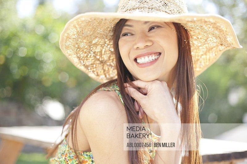Smiling Woman Wearing Straw Hat