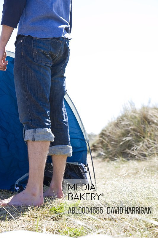 Portrait of a man legs standing by tent