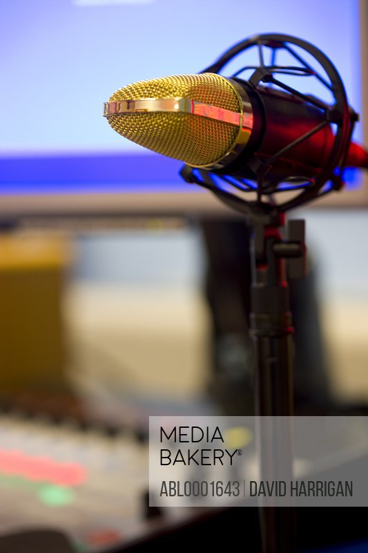 Close up of a gold microphone on a pedestal