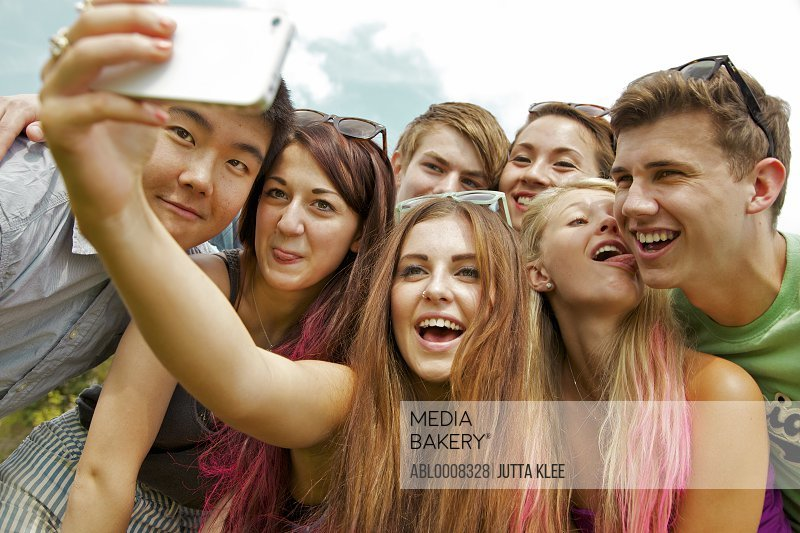 Group of Teenagers Taking Self Portrait Photo at Music Festival