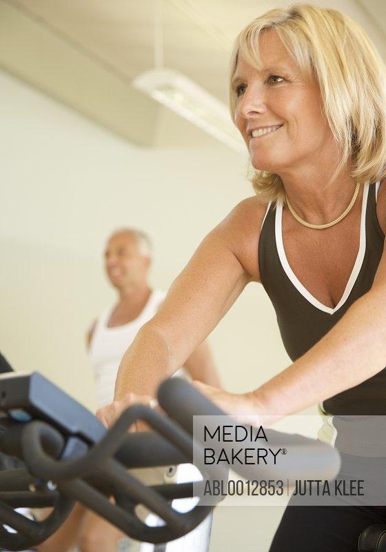 Woman on a gym bike