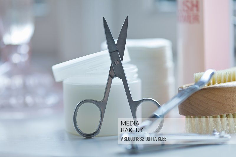Close up of nail scissors and manicure cosmetics
