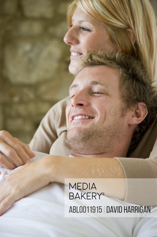Close up of a couple hugging and smiling