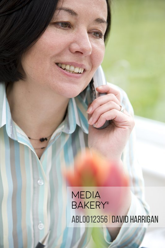 Woman talking on a cordless telephone