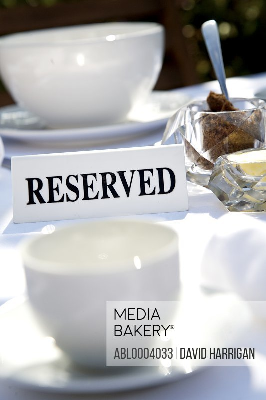 Close up of breakfast table with reserved sign