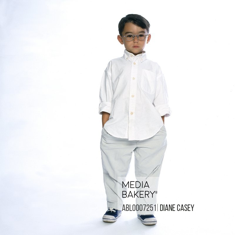 Boy Standing with Hands in Pockets