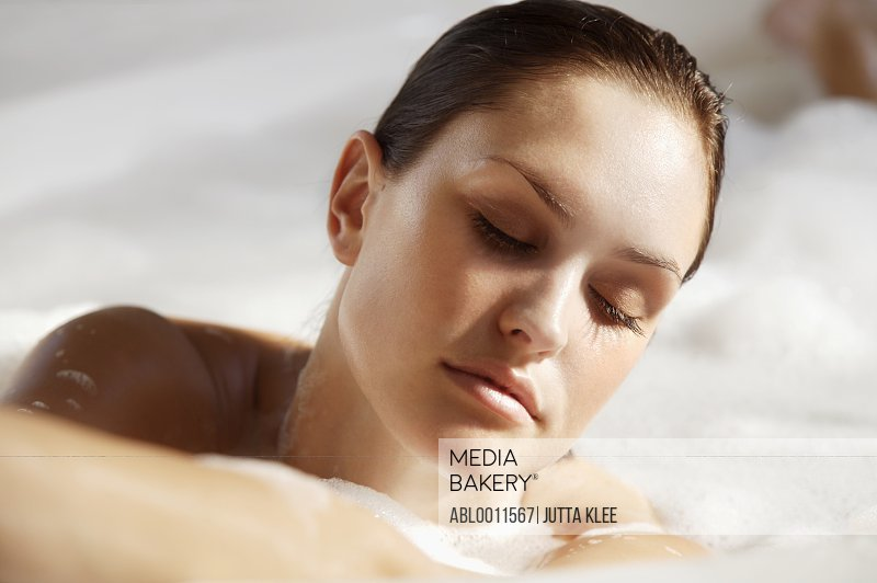 Young woman in a bubble bath