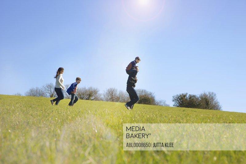 Family Running on Field