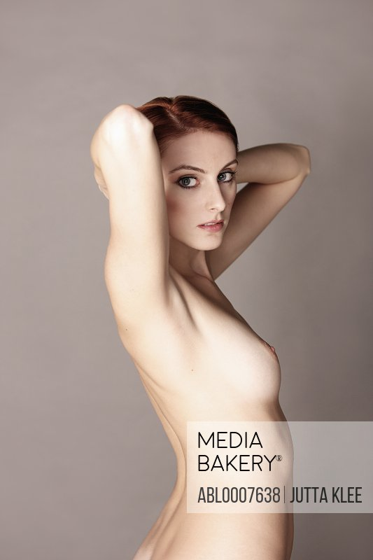 Nude Woman with Arms behind Head