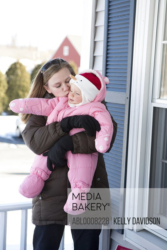 Woman Kissing Baby Girl