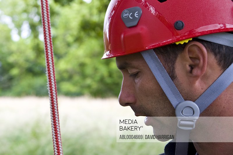Close up of climber wearing red helmet