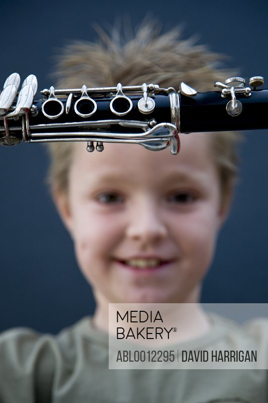 Smiling boy holding a clarinet