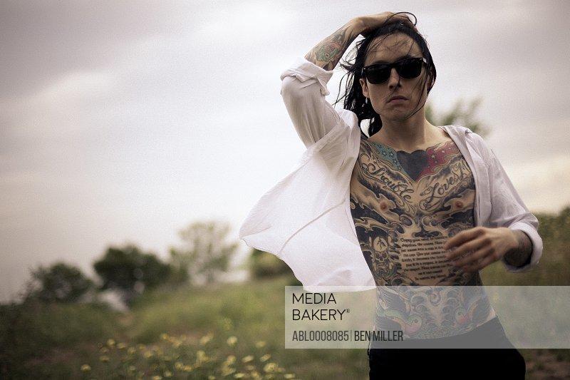 Portrait of Tattooed Man Outdoors